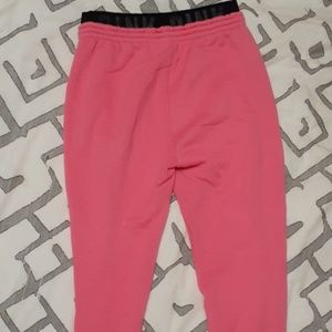 Pink Victoria's secret sweatpants.